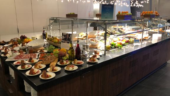 The buffet at LAX includes panettone french toast and a farro salad with fresh herbs.