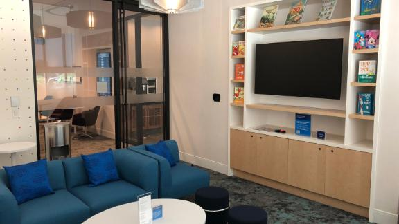 The lounge's multipurpose room features age-appropriate books for children.